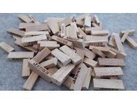 Mixture of Jenga bricks - some Uno bricks, some traditional Jenga bricks