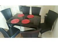 Black glass extendable dining table