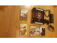 Xbox 360 with skin - black skulls , games , controller, cables. Delivery options available