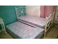 White metal single bed with white metal underbed trundle (including mattress) in excellent condition