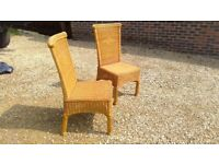 A pair of rattan chairs