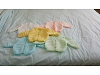 Selection of NEW hand knitted baby cardigans