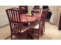 Mahogany dining table and 6 chairs. In excellent condition and very stylish.