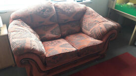 Large 2 seater sofa, armchair and a footstool