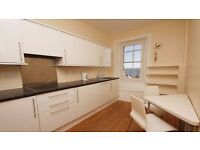 Large 2 Bedroom Top Floor Flat Within Town Centre.