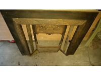 Victorian cast iron fireplace surround with original tiles.