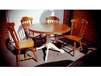 Round dining table and 4 solid chairs