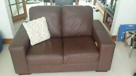 Nearly new Brown leather sofa. 3+2 seat.