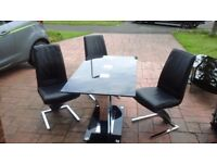 Chrome/black glass dining table & sideboard