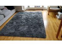 Large dark grey high pile rug