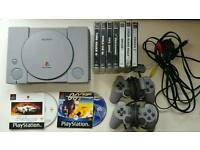 Playstation 1, 2pads and games.