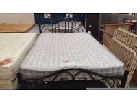 Black metal double bed frame and mattress set
