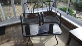 glass top table and 2 chairs grey metal, no seat cushions,
