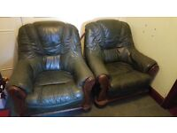 Two Second Hand Dark Green Leather Armchairs, one with slight tear.