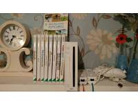 Wii console and 9 games accessories and cables
