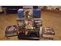 PS3 console with 21 games + 2 controllers