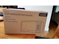BRAND NEW! NEVER BEEN OPENED! SILVER CONVENTIONAL MICROWAVE