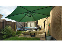 Large garden umbrella with stand.