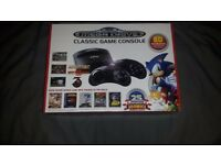 Retro sega mega drive with over 80 loaded games never been used all still in the box 60 pound ono