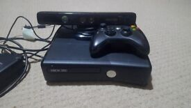 Xbox 360 with 8 games.