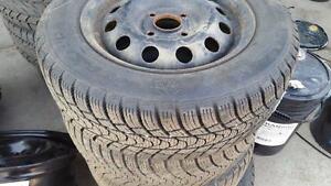 P185/65R14  winter tires on steel rims.