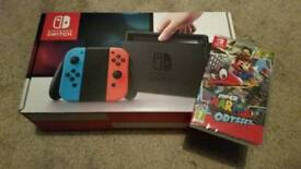 Nintendo switch + mario odysee ( sealed )
