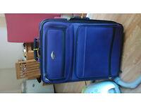 Large suitcase and folding rack