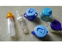 2 feeding squizable bottles and 4 sipping cups