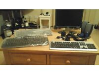 Dell Monitor and 3 keyboards