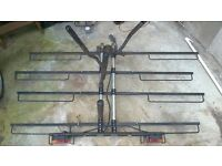 Bike carrier for up to 4 adult bikes that fits onto the car tow bar