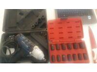 "Electric mechanics impact gun and sealy 1/2"" sockets"