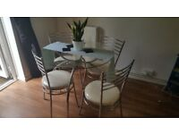 round glass dinning table and 4 chairs