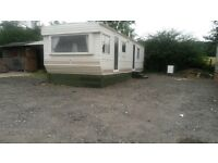 Two bedroom mobile home fully furnished with 10 acres of grazing land