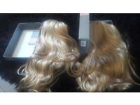 2 half head wigs never worn....still in original packaging