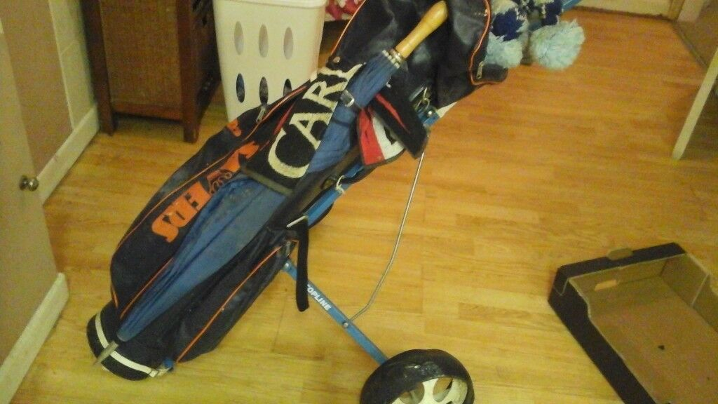 Set of all clubs in a caddy, on a trolley, balls and tees