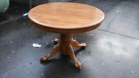 Extending pedestal dining table