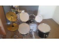 Drum kit - Junior Millenium black kit with kick, snare, three toms, hi hat and cymbal.