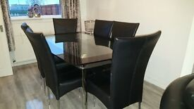 black/clear chrome glass table and 6 leather chairs