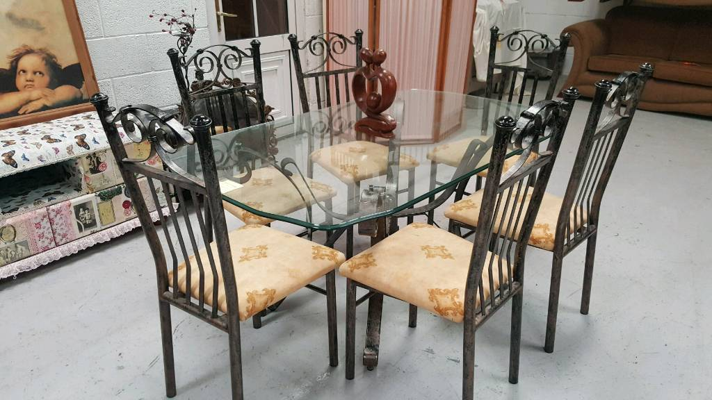 Ex stevensons large solid wrought iron dining table & 6 chairs can deliver 07808222995