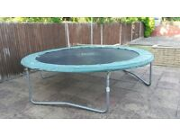 Plum 10 foot trampoline with security netting. Currently dismantled ready to take away. See photos.