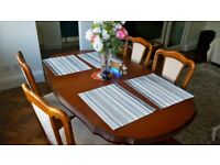 4-6 seat wooden table and 4 chairs