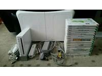 Nintendo Wii includes Wii Fit board and game and 16 other games