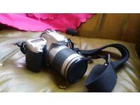 Nikon F75 SLR camera with AF NIKKOR 28-100mm lens