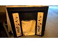 Cast iron fireplace - c/w gas fire, surround and inset tiles
