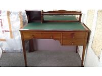 Early 20th century wooden desk with bevelled mirror inset