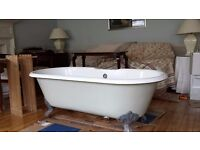 Beautiful double ended Roll top bath set up elegant claw feet