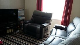 Brand New* electric reclining sofas.