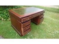 A green leather top pedestal desk