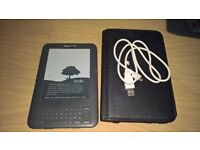 Kindle , with charger and case