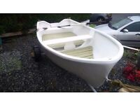 GRP Day Boat with road trailer.